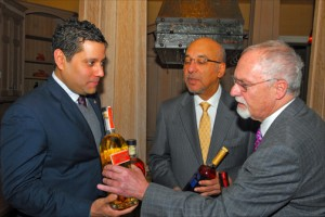 Ambassadors Neil Parsan (Trinidad & Tobago); Anibal de Castro (Dominican Republic) and John Beale (Barbados) compare bottles of their island's national rum brands. (Credit: Larry Luxner)