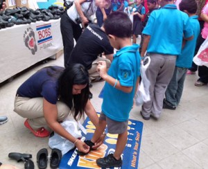 Company volunteers visited four schools across the city for the first shoe distribution events.