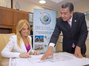 From left: Karen Artau, president and Ángel Álvarez, vice president of operations of Metro Pavia Health System review the blueprints for the planned expansion.
