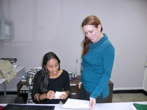 Women's Business Institute development manager Yomayra Ramos and administrative assistant Glendaly Aguilar work out of a spare office at Sacred Heart University.