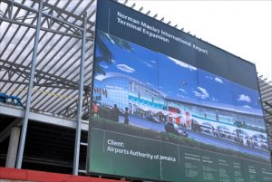 Billboard shows off future vision of Kingston's Norman Manley International Airport. (Credit: Larry Luxner)